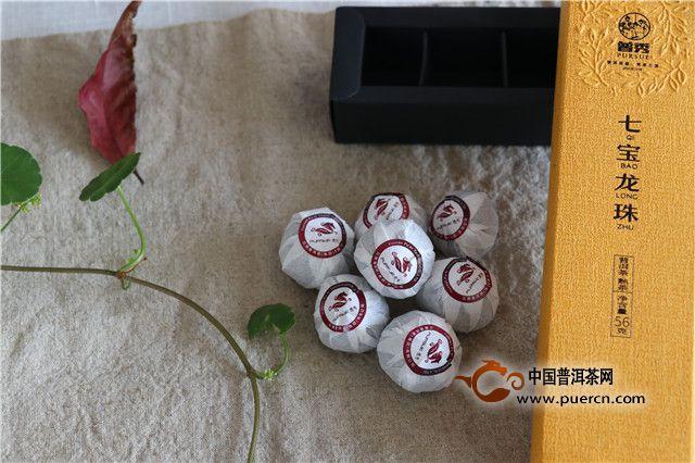"""普秀七宝龙珠的""""宝盒""""呈金黄色长方体,内含7个格子状黑色礼盒分别放"""