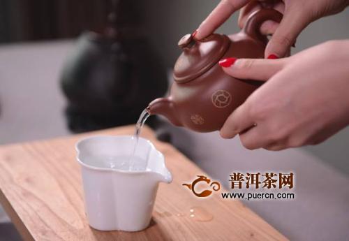 女士喝茶的手势